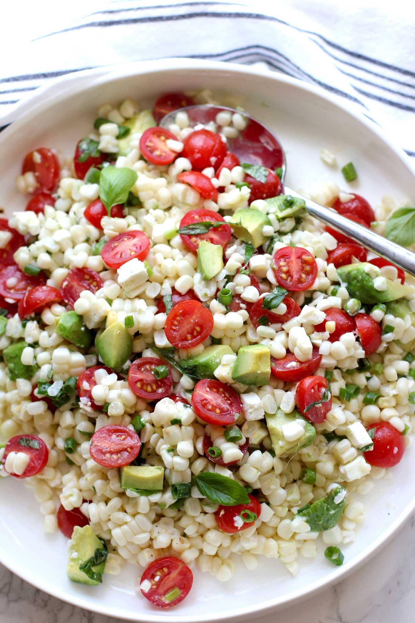 Fresh-Corn-Salad-With-Cherry-Tomatoes-And-Avocado-closeup